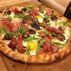 #pizzatuesday Easter #Pizza: Onion confit, buffalo mozzarella, baked eggs, roasted Easter egg radishes with brown butter and lemon juice, prosciutto, arugul...