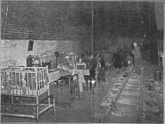 A typical scene from the Railway tunnel section of Ramsgate's deep shelters, showing beds and a child's cot. The narrow gauge railway track is still clearly visible. This has long since been removed
