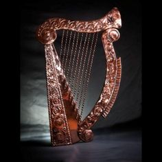 The Celtic Harp is probably the oldest of all stringed instruments and has been played in Ireland since ancient times.    It has been used extensively as the emblem of Ireland.    It is used by the Irish government and by Guinness our national drink.    This piece is 24″ high by 15″ wide and weighs approximately 800 grammes.