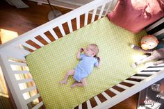 wide angle shot of baby sleeping in his crib