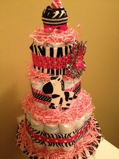 Baby Girl Pink Zebra Diaper Cake by CupcakeBabyTreats on Etsy, $67.00    Mom will go wild over this beautiful pink zebra cake!  Cake is ready to be personalized with baby girl's name.  Order yours today!