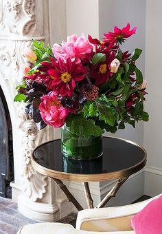 Smith adds a pop of color to the corner with a lush arrangement of bright blooms.