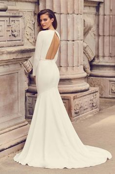 View Glamorous Long Sleeve Wedding Dress - Style from Mikaella Bridal. Crêpe gown with V-neck and long sleeves. Inverted V-back neckline with button closure at neck. Fit and flare skirt. Boho Wedding Dress With Sleeves, Crepe Wedding Dress, Simple Wedding Gowns, How To Dress For A Wedding, Open Back Wedding Dress, Western Wedding Dresses, Fit And Flare Wedding Dress, Long Wedding Dresses, Long Sleeve Wedding