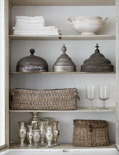 Love the mercury glass, baskets and old tin.  Nice juxtaposition.