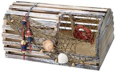 """Decorative Nautical Lobster Trap by HS. $65.95. It will add a nautical touch to whatever room it is placed in and is a must have for those who appreciate high quality nautical decor.. The lobster trap is made of wood and has fish net & seashells, buoys & a crab attached to it.. The decorative lobster trap measures 16"""" x 9"""" x 9"""".. It makes a great gift, impressive decoration & will be admired by all those who love the sea.. The decorative lobster trap measures ..."""
