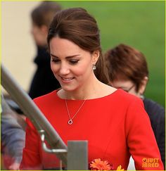 Kate Middleton & Prince William May Be Getting Prince Harry the Best Christmas Gift Ever | kate middleton shows tiny baby bump in red dress 04 - Photo