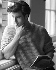 No, wait, what? WHAT?! Ok, I'm dead. He's too much. And he's holding a friggin book! - Aaron Johnson
