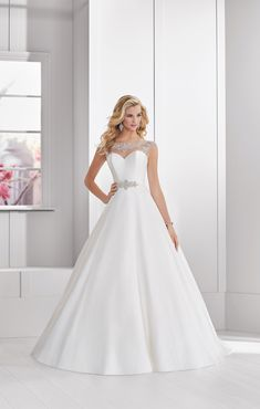 50a4d8421239 Ronald Joyce · A timeless mikado A-line gown with a beautifully beaded  illusion neckline and belt detail