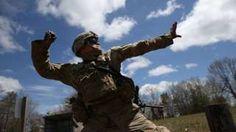 soldier throwing grenade