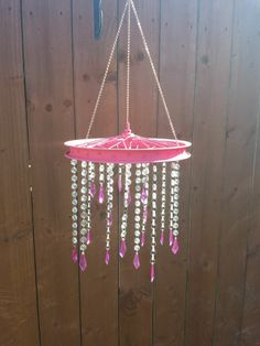 A pretty chandelier from an old bike wheel and some chandelier drops :)