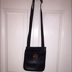 Michael Kors cross body Authentic Michael Kors cross body, used only a handful of times. Awesome condition some minor scratches on MK symbol but not noticeable without flash/light!! Great buy, bag needs a new home with some new love! KORS Michael Kors Bags Crossbody Bags