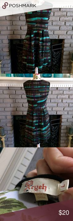 """💜Turquoise Purple Black Dress Office Workwear Beautiful purple/turquoise/black multi abstract-print sleeveless office chic dress! Flattering pleated elastic waist. Cute side pockets! Size adult Large. Acrylic/nylon, sweater material w/a good bit of stretch. EUC - only wear shown is perhaps color from washing. Only worn to the office a few times! App 34"""" length, depending on fit/height. Don't miss out on this beauty - blink and it could be gone! No trades/holds.  💜Bundle sale! Bundle 2…"""