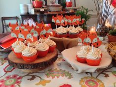 Cupcakes at fox themed baby shower.