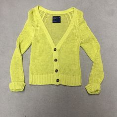 Neon Yellow Sweater Neon yellow color. Buttons down the front. Never worn before-- I took the main tag off but there is still a spare button tag on it. American Eagle Outfitters Sweaters Cardigans