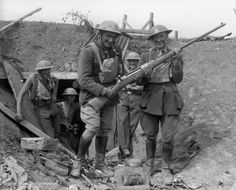 WWI, NZ officers pose with a captured German Mauser 1918 T-Gewehr anti-tank rifle.