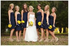 Navy bridesmaids dresses, with sunflower bouquets.
