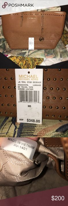 Michael Kors jet set Michael Kors studded jet set tote. NWT. Very roomy. Size 17L x 11H. Drop strap 8 inches. KORS Michael Kors Bags Totes