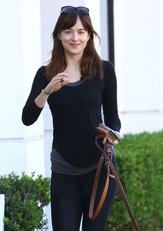 DAKOTA JOHNSON Walks Her Dog Out in West Hollywood