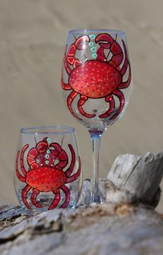 Original Design, Hand-painted 16 oz. Cabernet glasses and 15.4 oz stemless goblets, sold individually. This design features a large crab with a starfish on the reverse side. All designs are available in red, blue, purple, green, pink, teal, and many other vibrant colors. Wine Glass Crafts, Wine Craft, Wine Bottle Crafts, Wine Bottles, Beer Bottle, Decorated Wine Glasses, Hand Painted Wine Glasses, Decorated Bottles, Wine Glass Designs