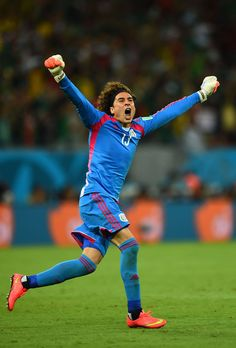 07bbe2f7918 FIFA World Cup 2014 - México 3 Croacia 1 Guillermo Ochoa of Mexico  celebrates his team's first goal during the 2014 FIFA World Cup Brazil  Group A match ...