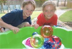 Chihuly inspired globes floating in a boat.TaDa! Art classes in Marble Falls, TX