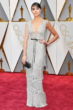 2017 Oscars: Olivia Culpo is wearing a silver fringe Marchesa dress with a black tie belt. I love the fringe and the beading. This dress has a 20s vibe!