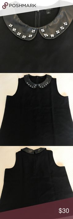 Ann Taylor black tank with crystal collar. NWOT NWOT Ann Taylor black tank with crystal collar. Cute black top with faux leather collar and crystal details. Easy to dress up or down. I bought it and haven't worn it. 😳 Ann Taylor Tops