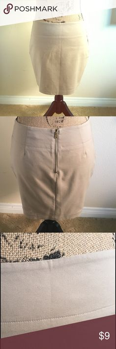 Khaki colored zip up miniskirt In excellent condition only worn a few times great stretchy material with a zipper back and small slit adorable on top of leggings Skirts Mini