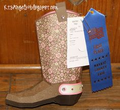 Check out the awesome First Place Blue Ribbon Katie won at the County Fair with her entry, the fabulous 3D Boot from HAPPY TRAILS SVG KIT.  I bet the judges were totally surprised when they found out it was made out of paper!  Awesome job, Katie!!