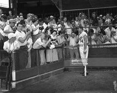 Brooklyn Dodgers great Gil Hodges chats with the fans at Ebbets Field in Brooklyn, New York.