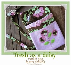 "Make my free ""Fresh as a Daisy"" market bag! The pocket features simple applique and embroidery."