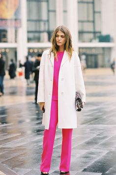 Elisa Sednaoui in Michael Kors bright pink top & trousers & white coat #NYC #StreetStyle