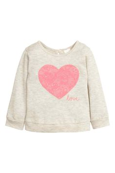 Fine-knit jumper in soft cotton with a motif on the front, an opening with a button at the back of the neck, long sleeves and ribbing at the cuffs and hem. H&m Kids, Baby Kids, Toddler Girl, Girls Clothes Shops, Simply Crochet, Baby Girl Tops, Pink Kids, Baby Online, Shirt Shop