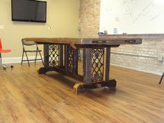 Conference table built out of reclaimed heart-pine and pieces of wrought-iron handrails