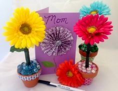 Flower pens in little pots, printable, customizable newspaper templates and 3-D flower cards.Read this blog for Great mother's Day Crafts!