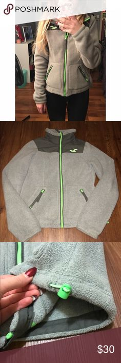 Hollister Fleece Jacket This gray and lime green jacket is a size small. Perfect condition! Very warm and comfortable! Will post more pictures upon request and I always accept reasonable offers! Hollister Jackets & Coats