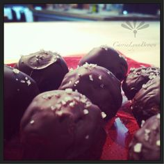 dark chocolate coated truffles with a white chocolate and rose cream and a sea salt sprinkle