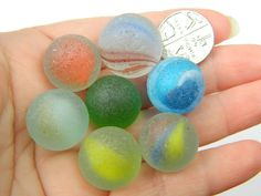ENGLISH SEA GLASS BEACH FINDS, 7 COLOURED MARBLES