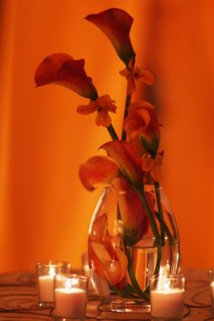 Mango calla lilies and candles