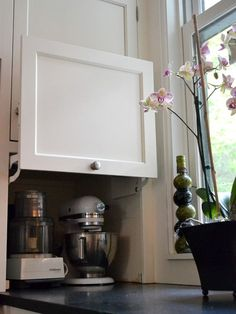 Fred must do this in our kitchen!!! Hidden corner storage to hide ugly appliances