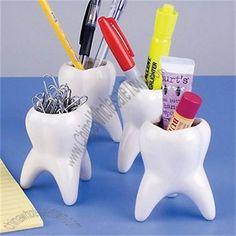 Molar shaped paper clip & pen holders.  Ha!