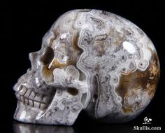 blue minerals and rocks | crazy lace agate # carved skull # stone # rock carved skull