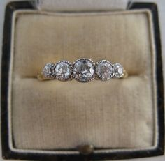 Vintage Five Stone Diamond Ring - this gives me an idea on what to do with some family diamonds.