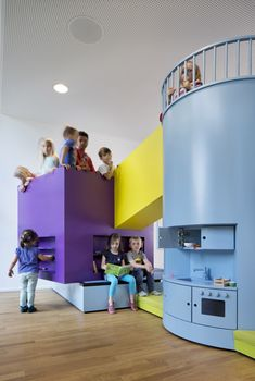 Kadawittfeldarchitektur have designed this day care in Hamburg, Germany. Abstract forms also hint at recognisable functions.