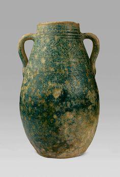 "Green Glazed Amphora - ADC.18 Origin: Syria Circa: 2 nd Century BC to 2 nd Century AD Dimensions: 14.25"" (36.2cm) high Collection: Pre-Islamic Art Style: Parthian Medium: Earthenware £24,000.00"