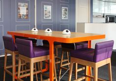 The furniture was supplied by Naughtone and we use orange frame to match the architecture of the building with a trace oak top. The Chairs are Lyndon oak frame with purple leather seating. The power modules are pluto from office electrics. Copyright: Workplace Creations Ltd.