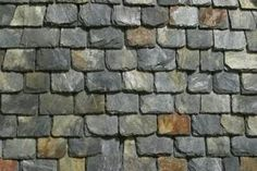 Recycled rubber roofs may be dusted with slate powder to provide a more authentic look.