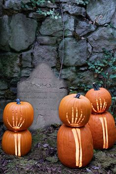 Skeleton hands carved on pumpkins give the yard a cool and spooky look