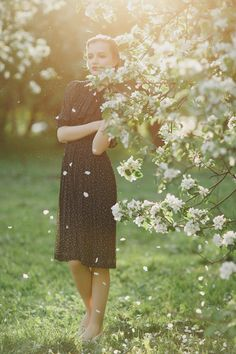 spring vintage style of the bride, bride in black dress among blossoming trees