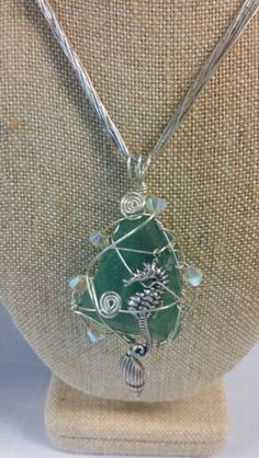 Sea glass wrapped in Argentium sterling silver by Jenny Carlile / Divine Jewels.